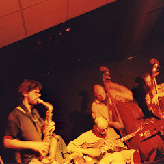 Philémon, Sam Shalabi, Nicolas Caloia, Alexandre St-Onge, and Jesse Levine (and on theleft side the trombone of Jacques Gravel) live at Le Va-et-vient [Photo: James Schidlowsky, Montréal (Québec), March 26, 2003]