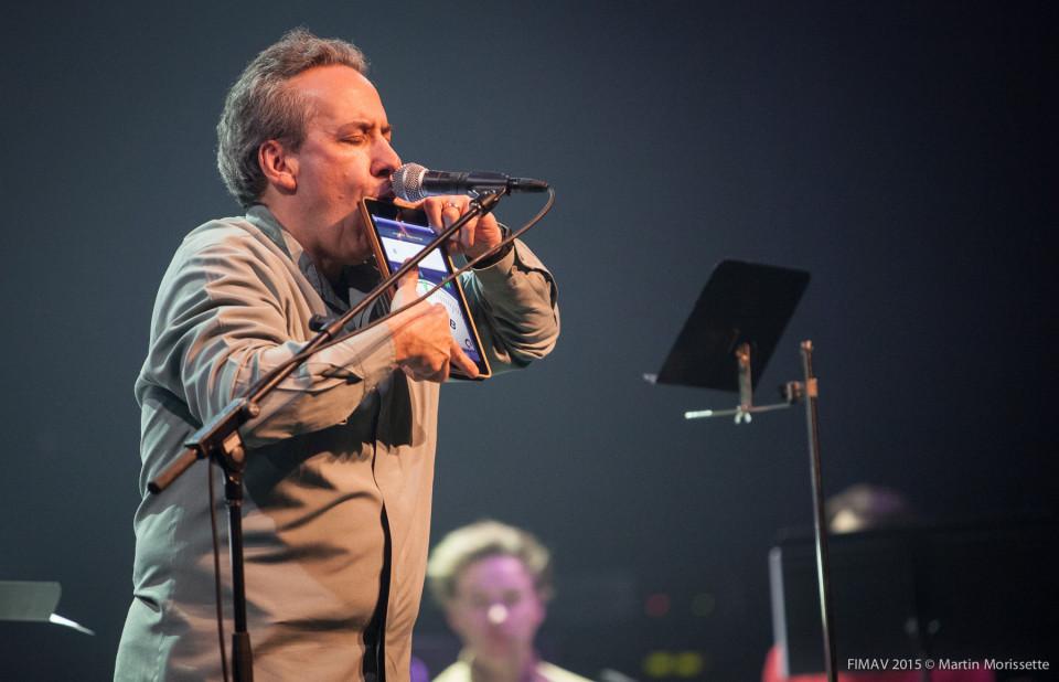 Jean Derome plays an iPad during a concert at FIMAV, 2015 edition [Photograph: Martin Morissette, Victoriaville (Québec), May 14, 2015]