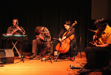 Jean Derome, Tony Wilson, Peggy Lee, Éric Normand improvising together at a concert [Photo: Laura Krutz Photography, Vancouver (British Columbia, Canada), November 21, 2016]