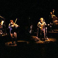 Acte 1: Nemo Vemba, Pierre Tanguay, Normand Guilbeault, Guido Del Fabro, Jean Derome, Daniel Soulières (danseur) et Pierre Hébert (images vidéo) [Photograph: Céline Côté, Montréal (Québec), March 16, 2006]