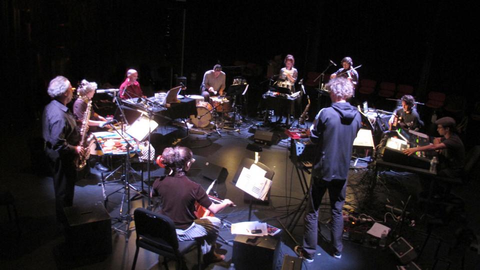 Ensemble SuperMusique (ESM) (left to right: Alexandre St-Onge; Guido Del Fabbro; Joane Hétu; Michel F Côté; Martin Tétreault; Danielle Palardy Roger; Jean Derome; Émilie Girard-Charest; Vergil Sharkya') (and Lévy Bourbonnais at the console) in concert in Montréal [Photograph: Céline Côté, Montréal (Québec), September 27, 2012]