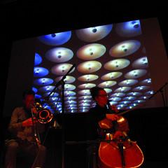The musicians Scott Thomson and Émilie Girard-Charest of the Ensemble SuperMusique (ESM) during Machinaction [Photograph: Robin Pineda Gould, Montréal (Québec), November 14, 2013]