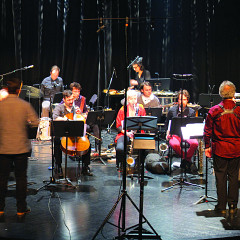 Ensemble SuperMusique (ESM): left to right, 1st row — Guido Del Fabbro; Joshua Zubot; Jean René; ; Lori Freedman; Philippe Lauzier; Joane Hétu; Jean Derome; Cléo Palacio-Quintin — 2nd row — Pierre-Yves Martel; ; ; Isaiah Ceccarelli; Bernard Falaise; ; Alexandre St-Onge; Martin Tétreault; Ida Toninato; Scott Thomson; Craig Pedersen [Photo: Céline Côté, Montréal (Québec), April 8, 2016]