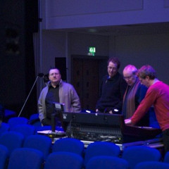 Jonty Harrison, Jean-François Denis, Denis Smalley, Pierre Alexandre Tremblay at the afternoon rehearshal for the concert empreintes DIGITALes @ 20: Cinema for the Ears as part of the Huddersfield Contemporary Music Festival [Photo: Scott Hewitt, Huddersfield (England, UK), November 24, 2010]