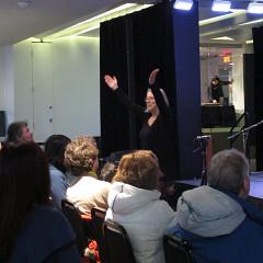 Diane Labrosse directing the audience during the concert of the choir Chorale Joker [Photograph: Céline Côté, Montréal (Québec), March 1, 2013]