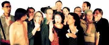 The choir Chorale Joker conducted by Joane Hétu; left to right: Gabriel Dharmoo; Manon De Pauw; Alexandre St-Onge; Diane Labrosse; Jean Derome; Michel F Côté; Géraldine Eguiluz; Elizabeth Lima; Joane Hétu; Éric Forget; Isaiah Ceccarelli; Lori Freedman; Marie-Neige Besner [Photo: Robin Pineda Gould, Montréal (Québec), June 19, 2014]