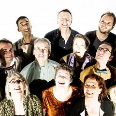 The choir Chorale Joker conducted by Joane Hétu; left to right: 1st row, Manon De Pauw; Diane Labrosse; Géraldine Eguiluz; Joane Hétu; Lori Freedman; 2nd row, Alexandre St-Onge; Jean Derome; Elizabeth Lima; Éric Forget; Marie-Neige Besner; 3rd row, Gabriel Dharmoo; Michel F Côté; Isaiah Ceccarelli [Photograph: Robin Pineda Gould, Montréal (Québec), June 19, 2014]