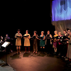 The choir Chorale Joker conducted by Joane Hétu in concert at the Phénomena Festival; left to right:Michel F Côté; Ida Toninato; Elizabeth Lima; Géraldine Eguiluz; Kathy Kennedy; Marie-Neige Besner; Lori Freedman; Diane Labrosse; Alexandre St-Onge; Gabriel Dharmoo; Éric Forget; Jean Derome; Isaiah Ceccarelli [Photograph: Robin Pineda Gould, Montréal (Québec), October 22, 2014]